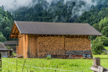Mountain house and firewood cuts in the countryside of Bavaria, Germany