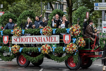 MUNICH, GERMANY - 16 OCTOBER 2017: Tent owners and breweries parade at the beginning of Oktoberfest - Schottenhamel tent parade