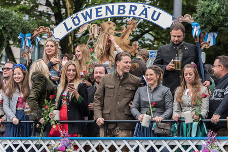 MUNICH, GERMANY - 16 OCTOBER 2017: Tent owners and breweries parade at the beginning of Oktoberfest - Lowenbrau parade Editorial