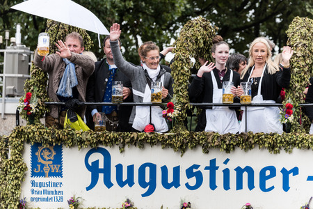 MUNICH, GERMANY - 16 OCTOBER 2017: Tent owners and breweries parade at the beginning of Oktoberfest - Augustiner parade
