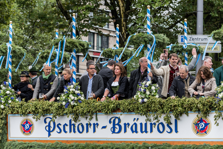 MUNICH, GERMANY - 16 OCTOBER 2017: Tent owners and breweries parade at the beginning of Octoberfest - Hacker Pschorr parade Editorial