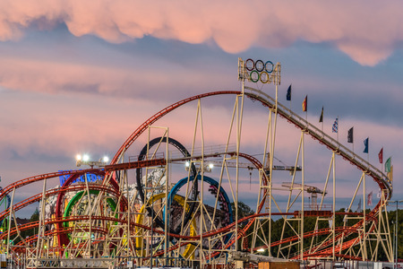 MUNICH, GERMANY - 16 OCTOBER 2017: View of rollercoaster in Oktoberfest during sunset