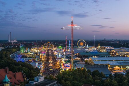 MUNICH, GERMANY - 22 SEPTEMBER 2017: Aerial view of Oktoberfest from St. Paul Cathedral during sunset
