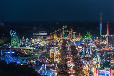 MUNICH, GERMANY - 22 SEPTEMBER 2017: Aerial view of Oktoberfest from St. Paul Cathedral at night