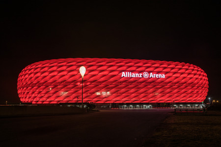 MUNICH, GERMANY - 26 SEPTEMBER 2017: Allianz Arena, the football stadium of FC Bayern, illuminated in red at night