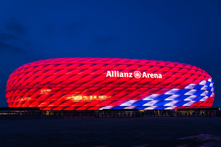 Munich, Germany - February 27, 2018: Allianz Arena special illumination for Bayern Munich 118th Birthday with bright red and white diamonds