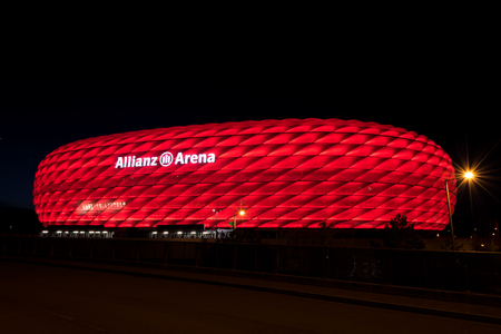 MUNICH, GERMANY - APRIL 29, 2018: Allianz Arena, the football stadium of FC Bayern, illuminated in red at night