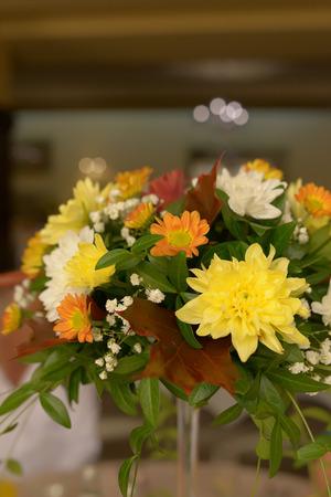 Autumn hues in a rustic bridal floral arrangement