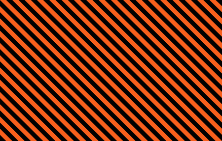 Orange and black Halloween inspired diagonal stripes with copy space, graphic resource as abstract background, textile print, wallpaper and geometric inspiration