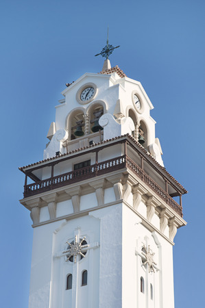 Close-up of the tower of Basilica de Nuestra Senora de la Candelaria, place of pilgrimage and shrine of Black Madonna, patron saint of Canary Islands, situated in Candelaria, Tenerife, Spain