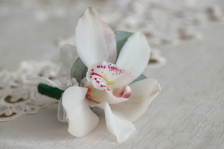 Single white orchid boutonniere, small floral arrangement for buttonhole, decoration for groom's and male guests' wedding attire