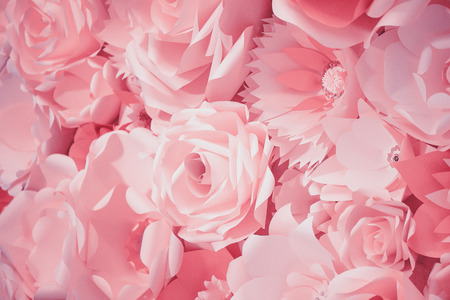 Color filter effect in pink of a 3D paper flower wall, decor idea or backdrop for weddings, baby shower, birthday or tea parties. Romantic three-dimensional monochrome decoration for background ideas.