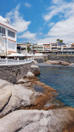 La Caleta, Costa Adeje, Tenerife, Canary Islands, Spain - May 5 , 2019: popular fishing village in the south of the island, transformed by the real estate industry into a coveted residential haven 新聞圖片