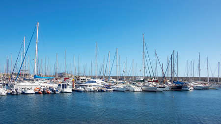 Marina San Miguel, Golf del Sur, Tenerife, Canary Islands, Spain - December 17, 2019: tranquil sports marina with 344 berths for large yachts and vessels, popular among year-round sailing aficionados 新聞圖片