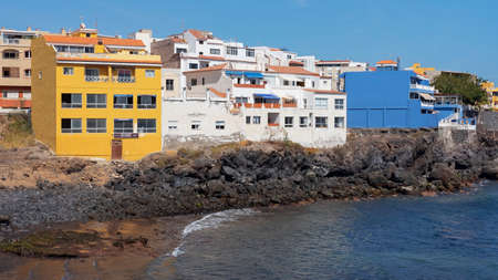 Los Abrigos, Granadilla de Abona, Tenerife, Canary Islands, Spain - March 17, 2019: typical architecture of a coastal village with colorful buildings and local restaurants facing a tiny volcanic beach