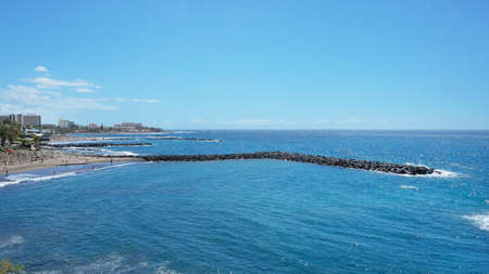Sunny day in Playa de Las Americas, an lively expansive resort in the south western part of the island, with numerous water attractions, hotels, venues and restaurants, Tenerife, Canary islands, Spain