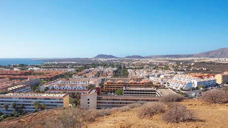 Costa del Silencio, Tenerife, Canary Islands, Spain - December 17, 2019: view towards Costa del Silencio and Las Galletas tranquil resorts from the top of Montana Amarilla in a winter hot sunny day