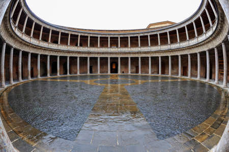 Palace of Charles V, in Alhambra palace and fortress, Granada, Andalusia, Spain - January 22, 2013: fish eye perspective of the circular courtyard inside the Renaissance Palacio de Carlos V building