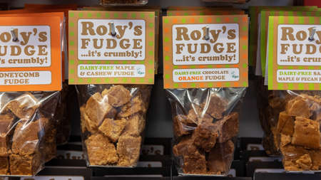 Roly's Fudge, Stratford-upon-Avon, UK - December 27, 2019: individually packed sweets with large labels displayed in a popular traditional shop, using an artisan method of making the best flavor fudge