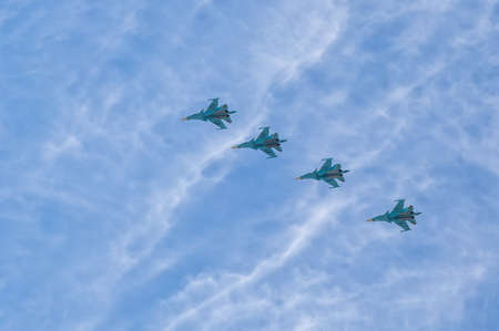 pilotage: Moscow Russian Federation May 9 2015. Group pilotage of the russian aerobatic teams at the airshow during the Victory Day parade.
