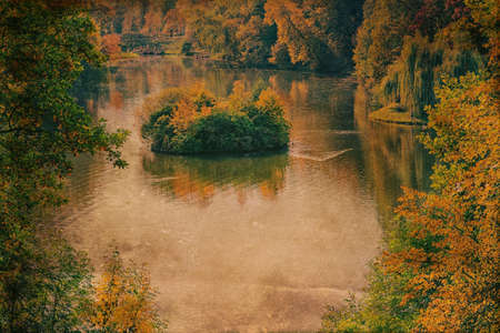 yellowed: Picture of a small island in the middle of the lake. Grunge and retro style.