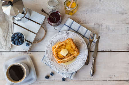 French toasts with butter and blueberries for breakfast. Top view. Фото со стока