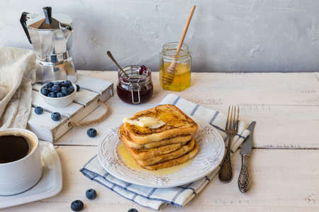 French toasts with butter and blueberries for breakfast.