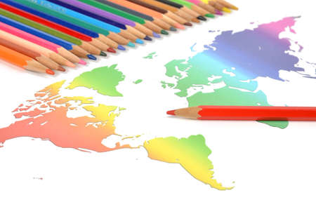 Color pencils and world map photo