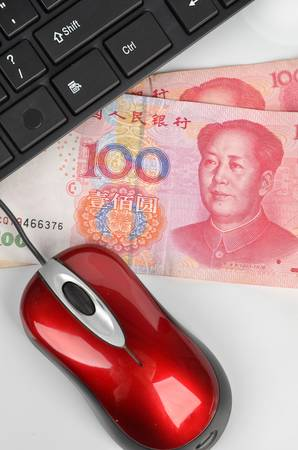 Computer mouse and chinese currency photo