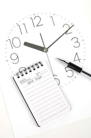 dial pad: Clock face and notepad with pen