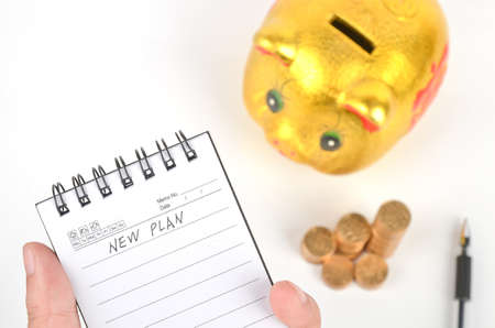 Magnifier and piggy bank with notepad photo