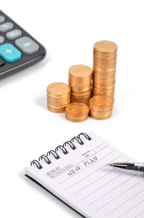 Calculator and notepad with coins photo