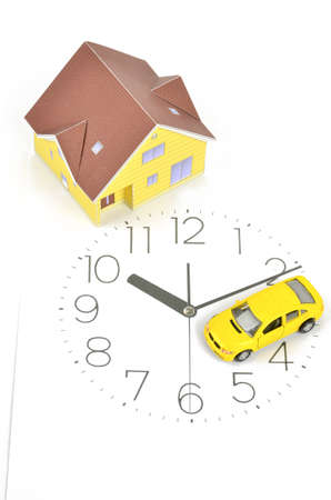 Model house,toy car and clock face photo