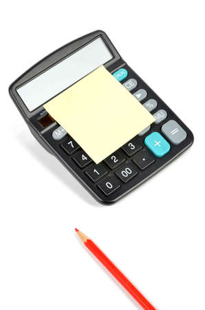 Post-it note ,calculator and pencils photo