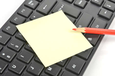 postit note: Post-it note ,keyboard and pencil