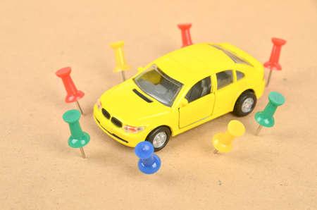 encircle: Toy car and push pin Stock Photo