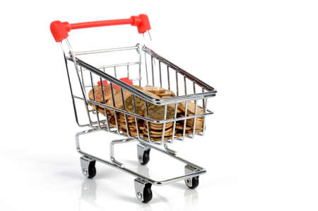 Coins in shopping cart Stock Photo - 12167145