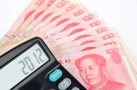 calculator chinese: Chinese currency and calculator Stock Photo