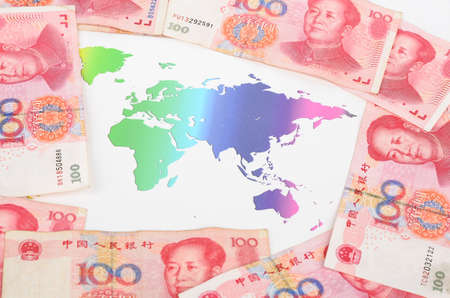 Chinese currency and world map photo