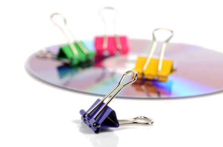 writable: Paper clips and DVD Stock Photo
