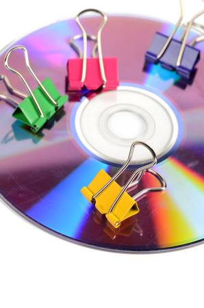 Paper clips and DVD Stock Photo - 12171767