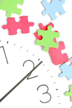 Puzzle and clock face photo