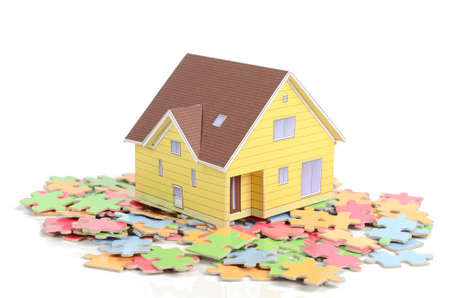 Puzzle and house model Stock Photo - 12171258