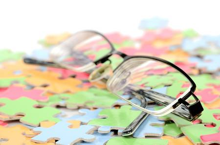Eye glasses and puzzle photo