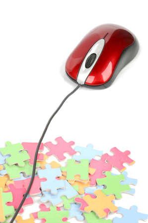 Computer mouse and puzzle Stock Photo - 12167401