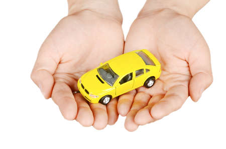 Toy car in hand Stock Photo
