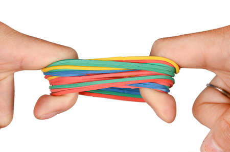 stretches: Rubber band and hand Stock Photo