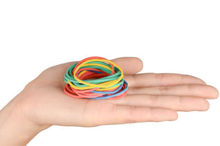 to restrain: Rubber band and hand Stock Photo