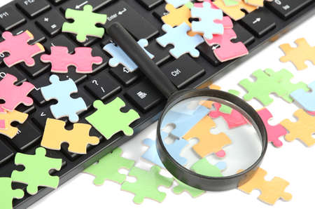 Keyboard,magnifier and puzzle photo