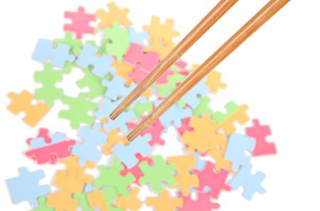 Puzzle and chopsticks photo